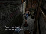 Resident Evil 3 Nemesis screenshot - Uptown - Warehouse back alley examine 02