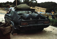 Mad-max-interceptor-at-scrap-yard-rear