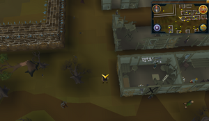 Scan clue West Ardougne west of north housing area