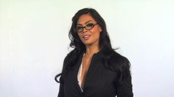 Tera Patrick wearing glasses in Saints Row 2 promo