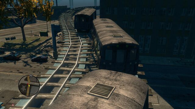 File:Top view of broken trains in Loren Square in Saints Row The Third.jpg