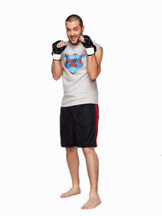 Goomer wearing boxing gloves