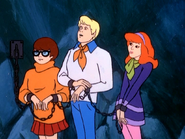 Fred and girls chained in Go Away Ghost Ship
