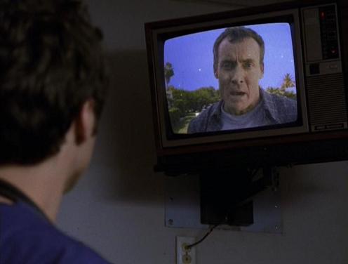 File:1x11CoxOnTV.jpg