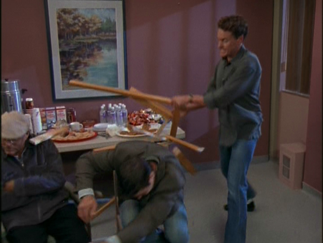 File:2x15 Cox smashes chair.png