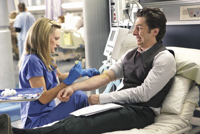 File:9x5 Lucy taking blood sample from JD.jpg