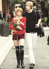 Bella-thorne-redwithboyfriendandpuppy