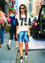 Zendaya-coleman-shiny-blue-shorts-sunglasses-earphones