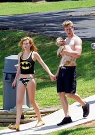Bella-thorne-Bristan-batman-top-over-bikini-with-Kingston-holding-hands