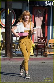 Bella-thorne-yellow-overalls-coffee-pink-box