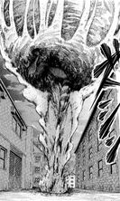 Eren carrying the boulder