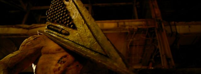 File:Red Pyramid, as he stops Missionary from killing Heather.jpg