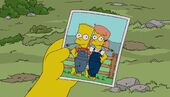 Bart holds photo of Mary and him