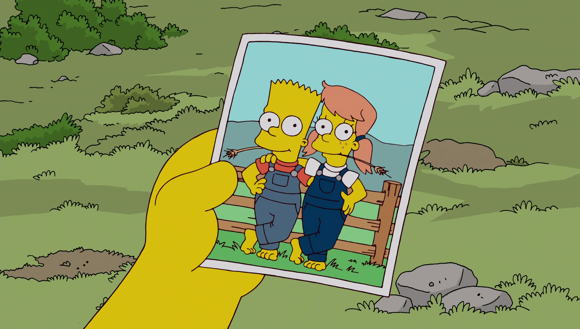 File:Bart holds photo of Mary and him.jpg