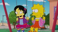 Lisa and Tumi on the swings