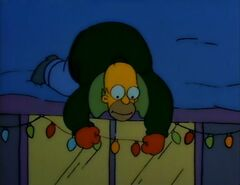 Homer sets up Christmas lights