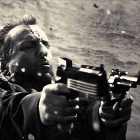 Hartigan fires the Auto 9 akimbo along with a Ruger Blackhawk.