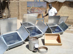 Gnibouwa Diassana with cookers and painting