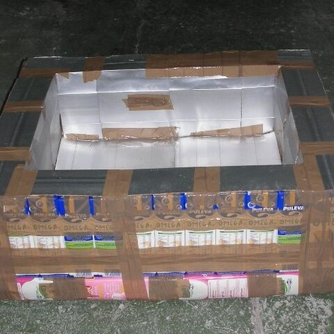 The completed enclosure constructed of juice boxes.