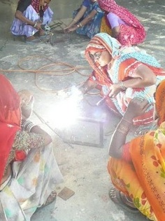 Barefoot College women students welding new Scheffler reflectors, 5-11