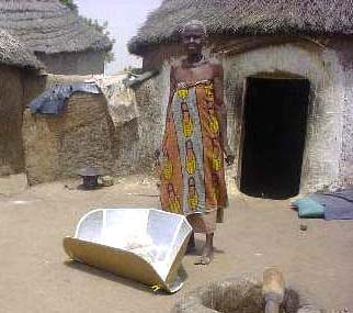 File:CooKit Solar Cooker in front of hut.jpg