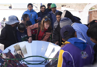 Virginia Bauso explains the workings of the parabolic solar cooker, 12-23-14