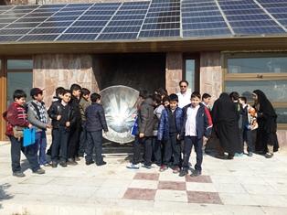 File:Amir Komarizade with parabolic cooker, 12-1-15.jpg.jpg