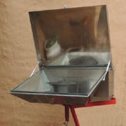 Through the wall solar cooker
