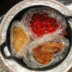 Rôti de porc, le riz et les poivrons
