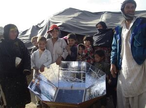 Trust in Education Afghan family with cooker, 4-7-13