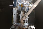 STS-125 EVA4 Working inside Hubble