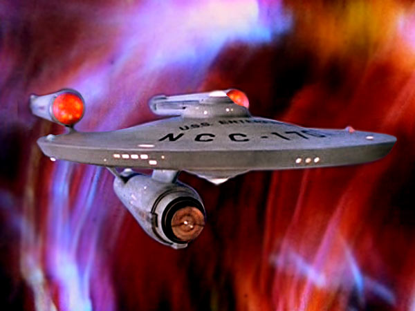 File:USS Enterprise (NCC-1701) at galactic barrier.jpg