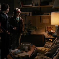 The boys questioning Eleven in Mike's basement.