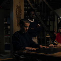 The boys watch as Eleven tries to explain Will's situation.