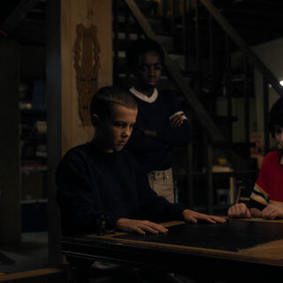 The boys watch as Eleven explains Will's situation.