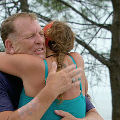Kimmi hugging her father at the <a href=