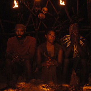 Cassandra and Earl at the Final Tribal Council.
