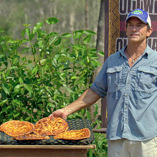 Jeff offering the contestants food in <i>Kaôh Rōng</i>.