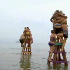 Both tribes competing in the final stage of the challenge.