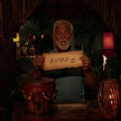 Joe votes for Aubry to win the game.