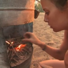 Amber building her fire (<i><a href=