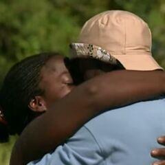 Cirie hugs her husband.
