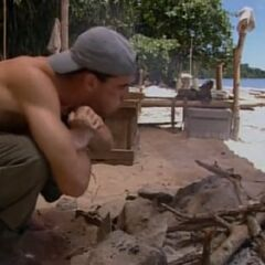 Sean making fire at Rattana camp.