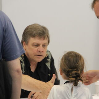 Mark Hamill signs an autograph for a young fan.