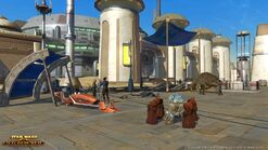 Jawas inspect an astromech droid