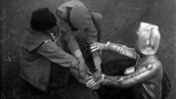 Cyberman Breaks Out Of The Sewer - The Invasion - Doctor Who - BBC