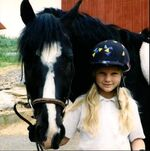 Young Taylor with her horse
