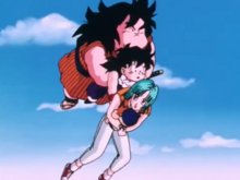 Gohan carries Yajirobe, Bulma and Trunks