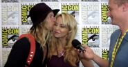 Greg Cipes kisses Tara Strong SDCC 2016