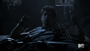 Teen Wolf Season 4 Episode 11 A Promise to the Dead Scott tied with straps and wolfsbane